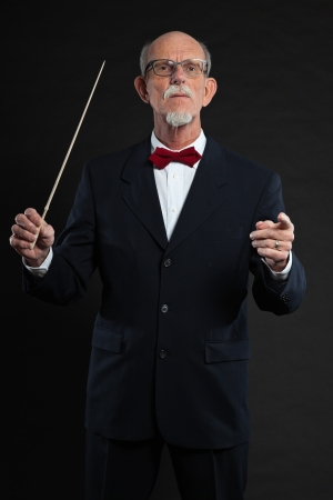 Senior conductor wearing suit. Studio shot. Stock Photo - 19001990