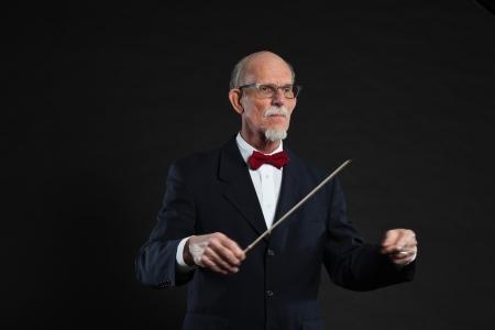 Senior conductor wearing suit. Studio shot.  Stock Photo - 19001873