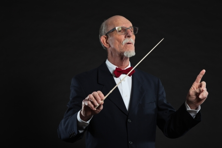 Senior conductor wearing suit. Studio shot. Stock Photo - 19001940
