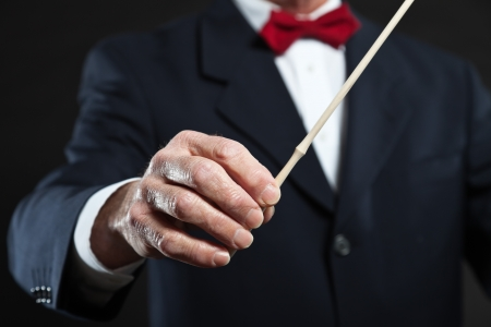 conducting: Conductor conducting an orchestra isolated.