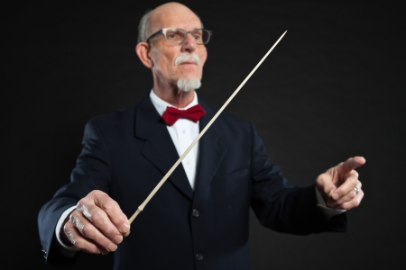 Senior conductor wearing suit. Studio shot.  Stock Photo - 19001859