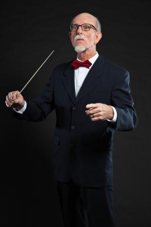 Senior conductor wearing suit. Studio shot. Stock Photo - 19001906