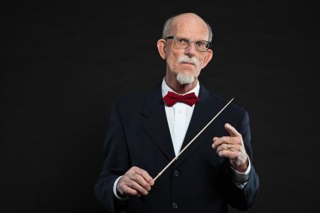 Senior conductor wearing suit. Studio shot. Stock Photo - 19001908