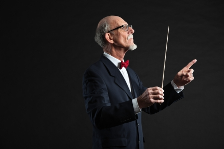 Senior conductor wearing suit. Studio shot.  Stock Photo