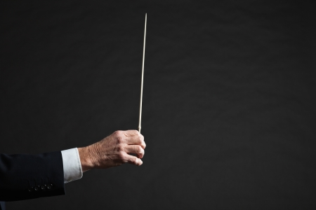 Conductor conducting an orchestra isolated. photo