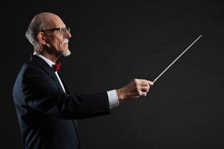 Senior conductor wearing suit. Studio shot.  Stock Photo - 19001943