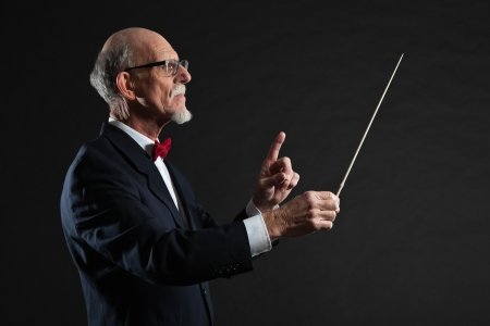 Senior conductor wearing suit. Studio shot.  Stock Photo