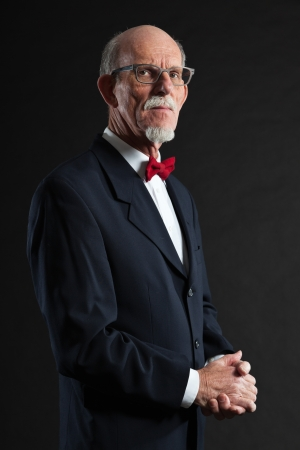 Senior man wearing suit and red tie. Studio shot. photo