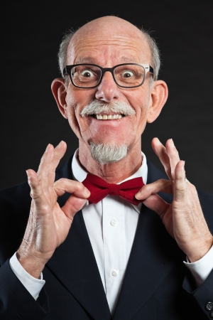 Funny senior man wearing suit and red tie. Stock Photo - 19002072