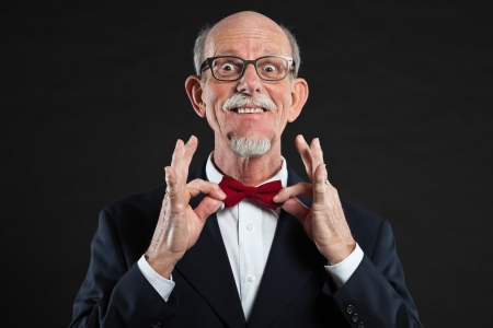 Funny senior man wearing suit and red tie. Stock Photo