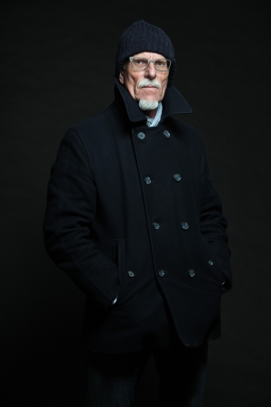 Good looking senior man winter fashion. Studio shot. photo