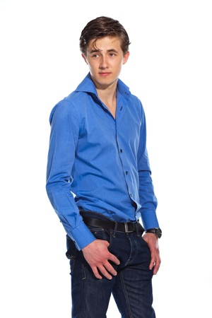 Young business man wearing blue shirt and jeans. Isolated on white. photo