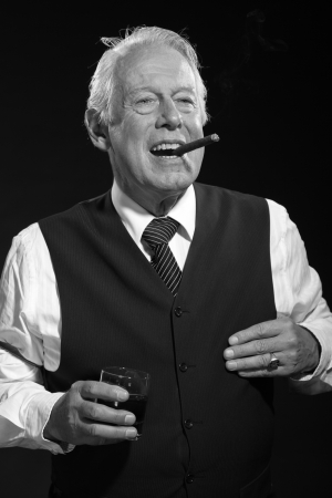Retro senior business man with whisky smoking cigar. Black and white photo. photo
