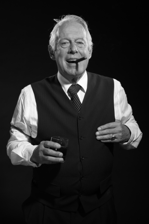 Retro senior business man with whisky smoking cigar. Black and white photo. photo