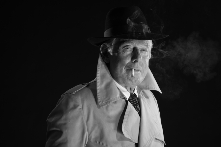 Retro mafia man with hat smoking cigarette. Black and white photo. photo