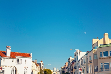 Street with houses of San Francisco with blue sky. photo