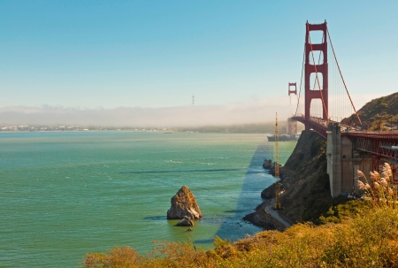 Golden Gate Bridge with clouds and blue sky. San Francisco. USA. photo