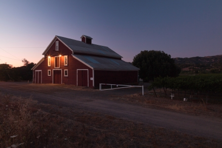 Red barn from wine farm at dusk. Napa Valley. California. USA. photo