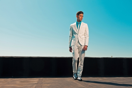 Vintage summer fifties fashion man wearing white suit and tie