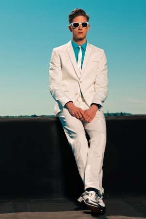 Retro fifties summer fashion man with white suit and sunglasses