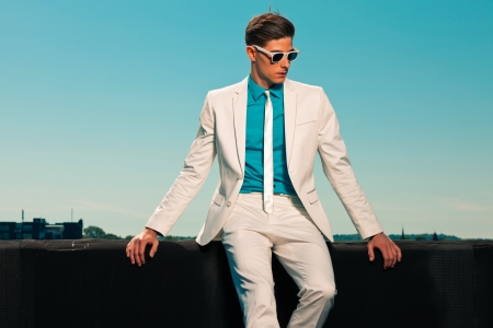 fashion: Retro fifties summer fashion man with white suit and sunglasses