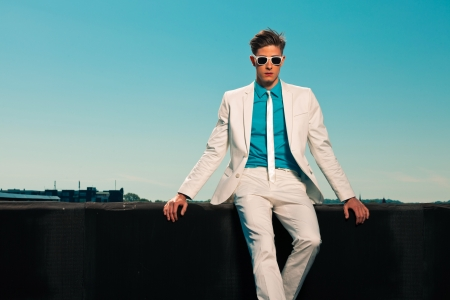 Retro fifties summer fashion man with white suit and sunglasses Stock Photo - 19879474