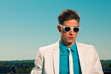50s fashion: Retro fifties summer fashion man with white suit and sunglasses