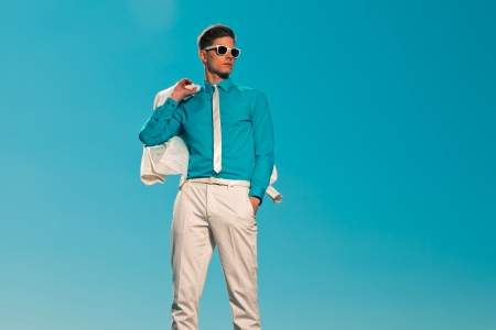 Retro fifties summer fashion man with white suit and sunglasses Stock Photo - 19879462