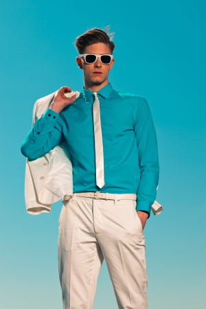 Retro fifties summer fashion man with white suit and sunglasses photo
