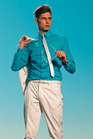 Vintage 50s summer fashion man with white suit holding jacket and sunglasses Stock Photo - 19879457