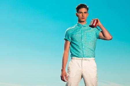50s fashion: Retro fifties summer fashion man in blue shirt listens to portable radio Stock Photo