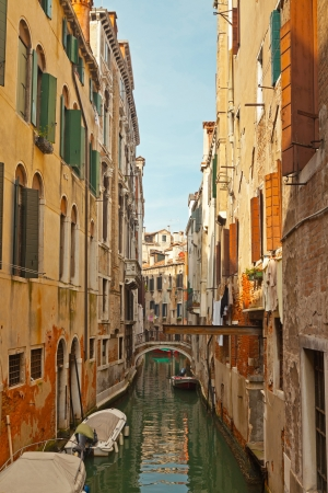 The canals of Venice with colorful houses. Italy. photo