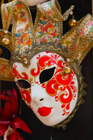Colorful traditional venetian mask at souvenir shop. Venice. Italy. photo