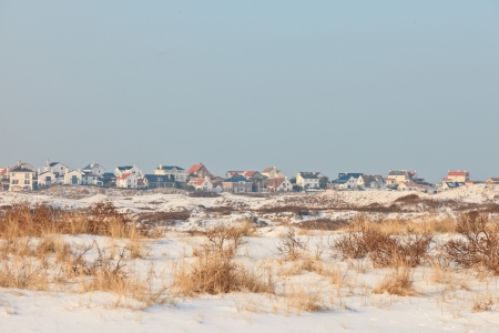 Winter dunes with skyline of Zandvoort and blue sky. The Netherlands. photo