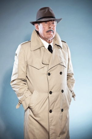 private detective: Retro detective man with mustache and hat Wearing raincoat