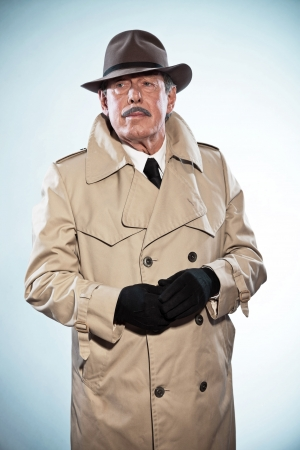 Retro detective man with mustache and hat Wearing raincoat