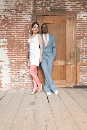 mixed marriage: Vintage fashion romantic wedding couple in old urban building. Mixed race. Stock Photo