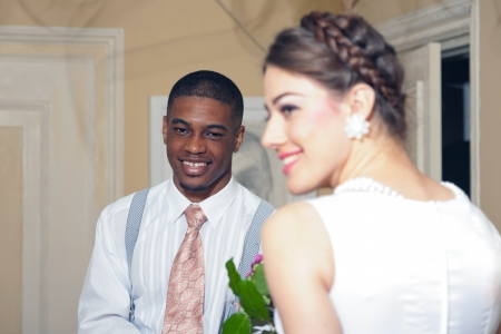 Retro fashion romantic wedding couple in old classic interior. Mixed race. photo