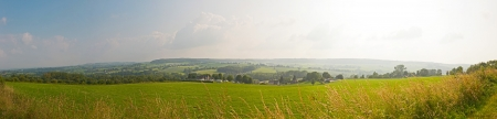 unblemished: Hill landscape with meadow and trees and blue cloudy sky. Panoramic shot. Zuid Limburg. The Netherlands.