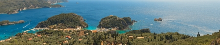 Beautiful panoramic shot of paradise bay with blue water and sky and green mountains. Corfu. Greek. Island. photo
