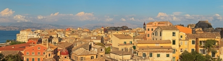 Panoramic shot of Corfu city with blue cloudy sky  Sen from above  Kerkyra  Corfu island  Greece  photo