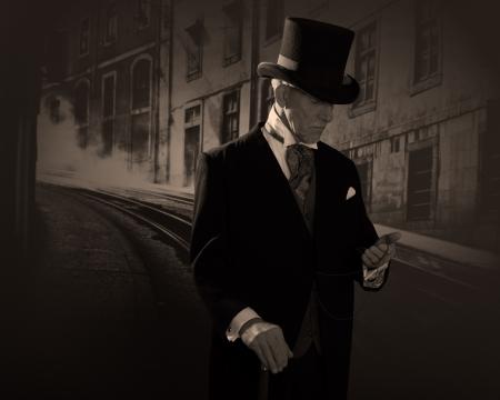 Homem 1.900 estilo vestindo chap Banco de Imagens