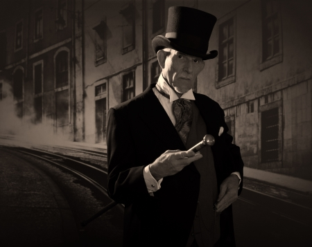 Man 1900 style wearing black hat and coat. Dickens style in night city street. Stock Photo
