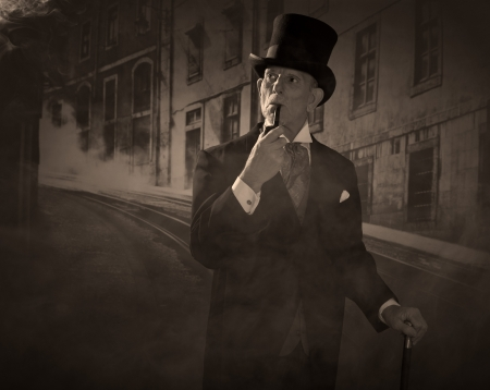 dickensian: Man 1900 style smoking a pipe wearing black hat and coat. Dickens style in night city street.