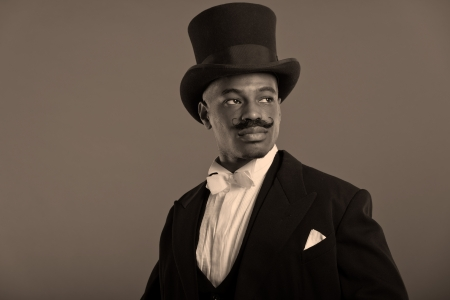 dickens: Retro afro american dickens scrooge man with mustache  Wearing black hat