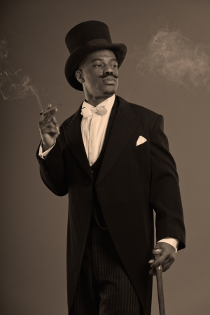 dickens: Retro afro american dickens scrooge man with mustache. Wearing black hat. Smoking a cigar. Stock Photo