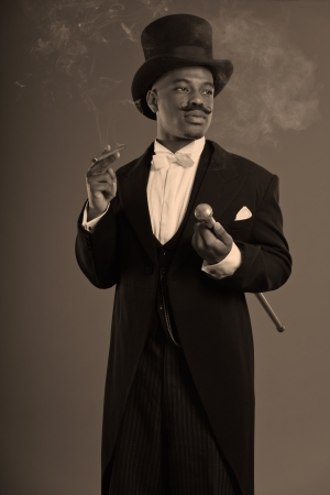 scrooge: Retro afro american dickens scrooge man with mustache. Wearing black hat. Smoking a cigar. Stock Photo