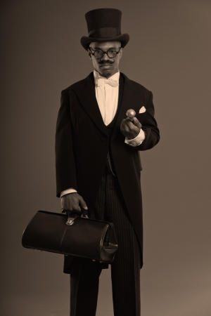 scrooge: Retro afro american dickens scrooge man with mustache. Wearing black hat and glasses. Holding a city bag.