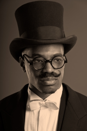 scrooge: Retro afro american dickens scrooge man with mustache. Wearing black hat and glasses. Close-up portrait.