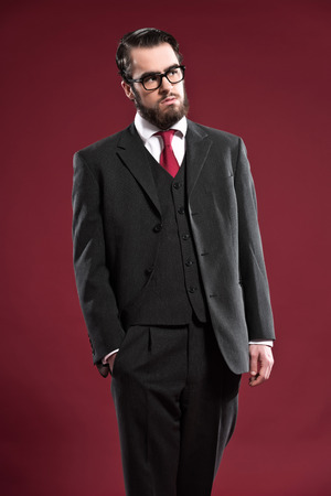 Retro 1900 Fashion Man With Beard Wearing Grey Suit Red Tie And ...
